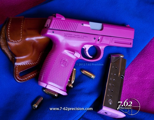 Magenta (barney purple) S&W Sigma SW40VE Pistol with pink accents
