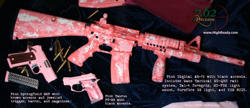 Pink digital camouflage on AR with engraving (last name removed for this photo). Springfield EMP 1911 finished pink and brown and jewelled. Taurus PT22 in pink and black.
