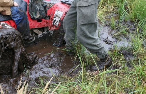 Extracting a hunting partner's four-wheeler from the mud.