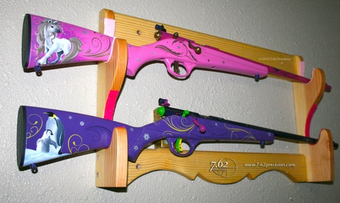 Savage Rascal .22 rifles in pink with unicorn and purple with penguins.