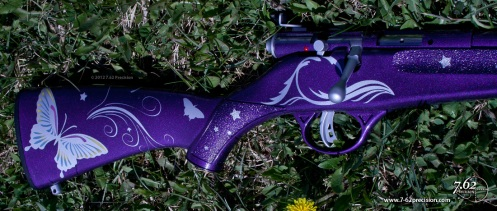 Savage Rascal .22 rifle in purple and silver with butterflies