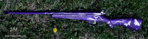 Purple Savage Rascal rifle with silver accents and butterflies for a young girl