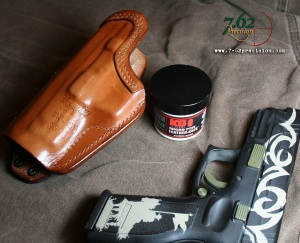 A light application of KG-9 Leather-Kote and a tight new holster worked like it was well broken in. We will wait and see what the long-term results are.
