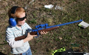 A six-year old immediately after firing a shot from a Savage Cub Rifle. Notice that as soon as the shot was fired the trigger finger has been moved out of the trigger guard and is placed along the stock above the trigger.