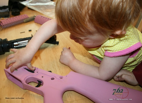 A two-year old pays enough attention when watching her father to correctly place parts in a Cavalry Arms lower when given the opportunity.