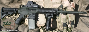 M4-style carbine outfitted with Israeli military accessories: GLR-16 stock, AG-43 grip, PEC ejection port cover, MWG magwell grip and funnel, T-POD vertical foregrip with built-in bipod, and FGR-3 tri-rail hanguard system.