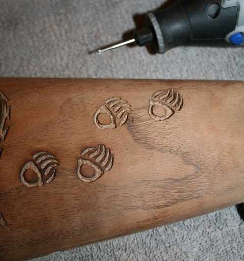 Carving on the Marlin stock with Dremel burrs.
