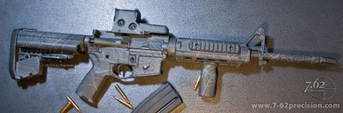 AR-15 Rifle in Gray Spider Web pattern with Red Tail spider on magazine well. Magpul MOE handguards and fore grip, EOTech Sight, VLTOR Stock.