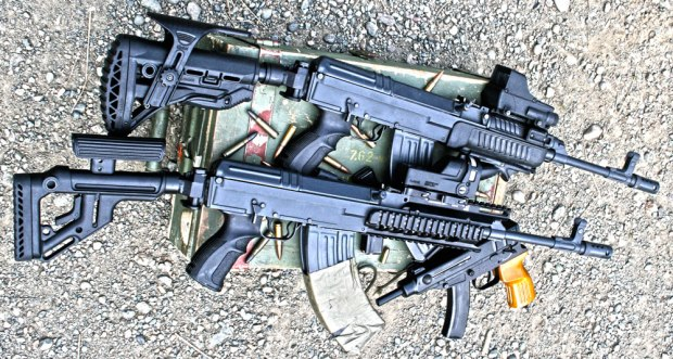 vz.58 rifles with accessories, including SA-58 handguard, VFR-VZ Rail System, AG-58 Grips, UAS Folding Stock and Folding Recoil-Compensating Stock System with GL-SHOCK and Cheekpeice. Optics are Mepro M21 and Mepro TRU-DOT RDS.