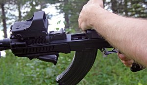 Right-handed charging over the top of the rifle