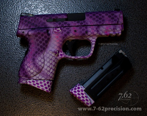 Crimson Trace Laser Grip DuraCoated to match pistol.