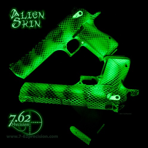 Twin Desert Eagle pistols in a glow in the dark Alien Skin finish.